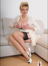Bigtitted English lady showcases her contrast top and seam nylons