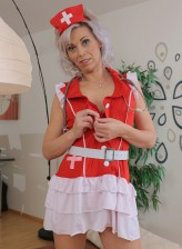 Grey-haired nurse Kathy White strips her lacy red lingerie for effective pussy treatment