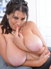 Big breasted housewife Lulu Lush showing off her big assets