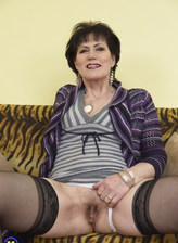 Horny mom reveals white lingerie and shamelessly parts legs in black stockings to pleasure her bush