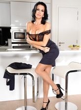 Smartly dressed Veronica Avluv parades her lingerie and stockings in the kitchen