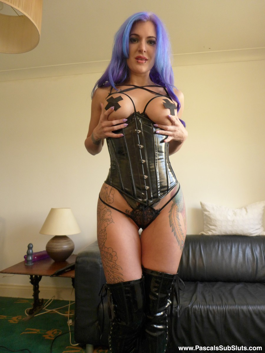 Purple-haired tattooed slut Alexxa Vice spread-eagles in her leather corset  and thigh high boots