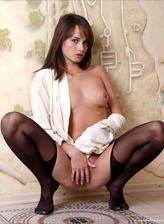 Beautiful girl spreading legs in her sexy black suspender tights