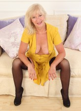 Bigtitted mature blonde Emily Jane pushes a pink toy between her stockinged legs