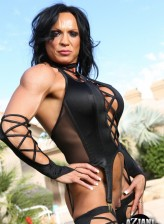 Hard-bodied Rhonda Lee flexes outdoors in her lace-up lingerie with matching stockings and gloves