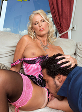 Sexed-up blonde milf Charley Rose in pink-trim RHT stockings and corset set fucks her handyman
