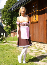 Cute country girl Karol Lilien lowers her white opaque hose for outdoor toy play