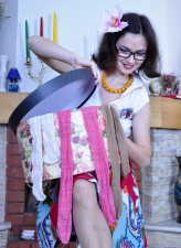 Dolled up girl in glasses trying on various patterned pantyhose
