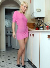 British blonde Evey Crystal in a pink dress and shiny control top pantyhose
