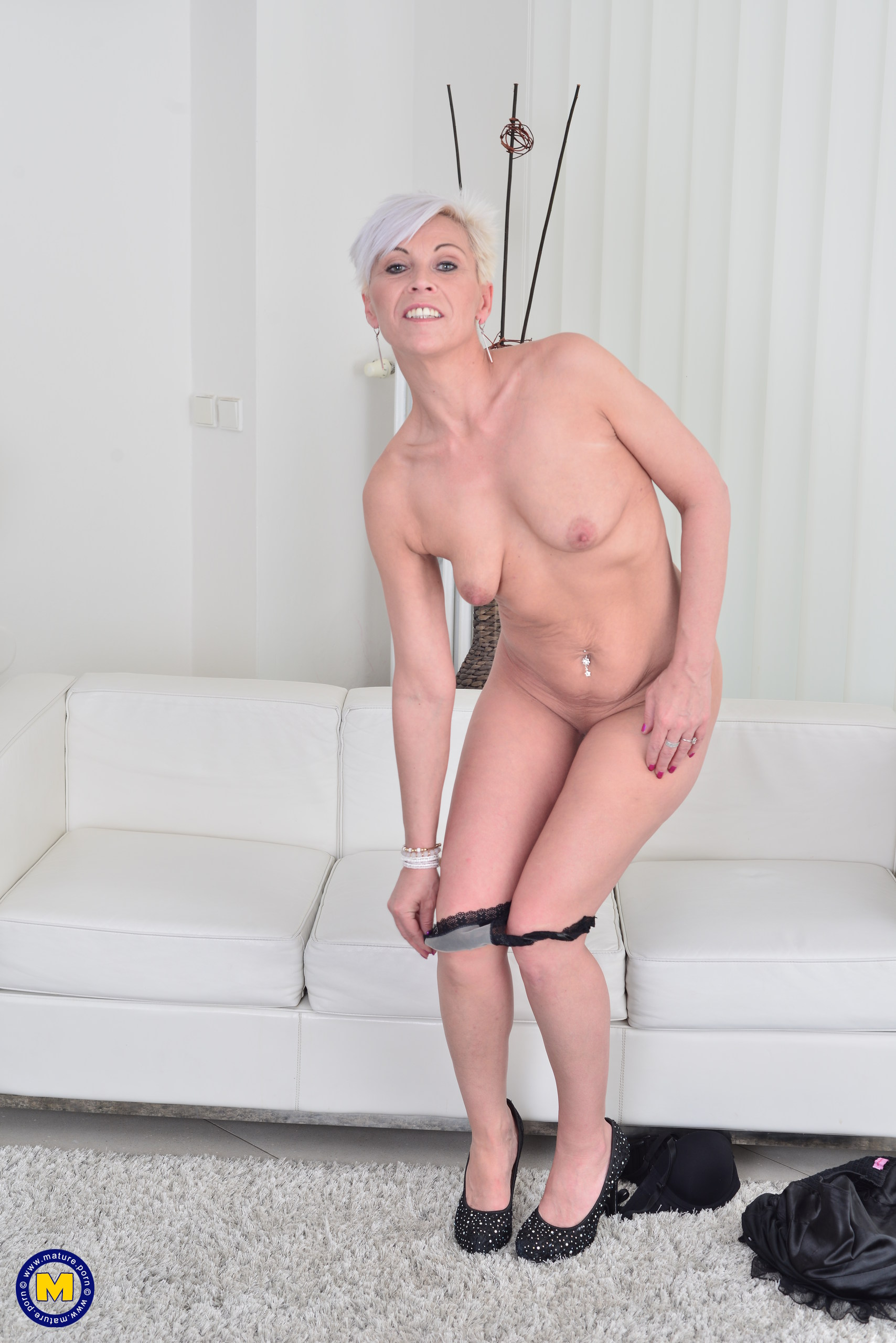 Mature blonde and her young lover enjoy their fuck 3