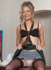 Nasty student flashes her retro seamed stockings in detention