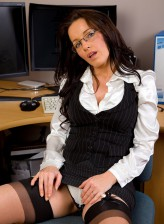 Mature secretary in elegant black-n-white undies and sheer nylons