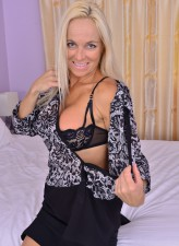 Milf Dani Dare puts on a bedroom strip show boasting her lacy bra and G-string