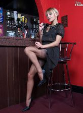 British babe Zoe Dee strips in the pub to her nylons and frigs her self