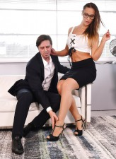 Nerdy office girl Naomi Bennet gives a nylon footjob before a round of foot sex