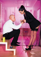 Dark-haired mistress in fully-fashioned stockings draining a stud