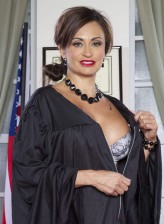 Supreme Court justice Claudia Valentine reveals sexy seamed nylons under her robe