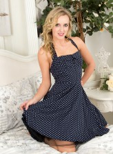 Curly UK blonde Skye Taylor peels her polka-dot dress and lowers sheer pantyhose to get naughty