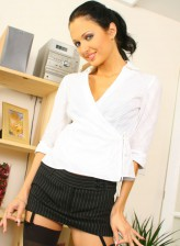 Hot brunette secretary Roxanne Milana in stockings and heels spreads thighs