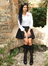 Smiley brunette flashes and fingers outdoors in her schoolgirl uniform and black knee-highs