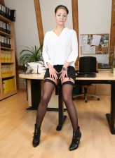 Sexy German secretary Mareen Deluxe spreading legs and fingering her pussy