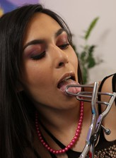 Ashley Ocean deals with a speculum and big jelly toy wearing a sexy bodystocking