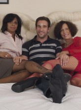Two horny fishnet clad UK moms have interracial sex with a young guy