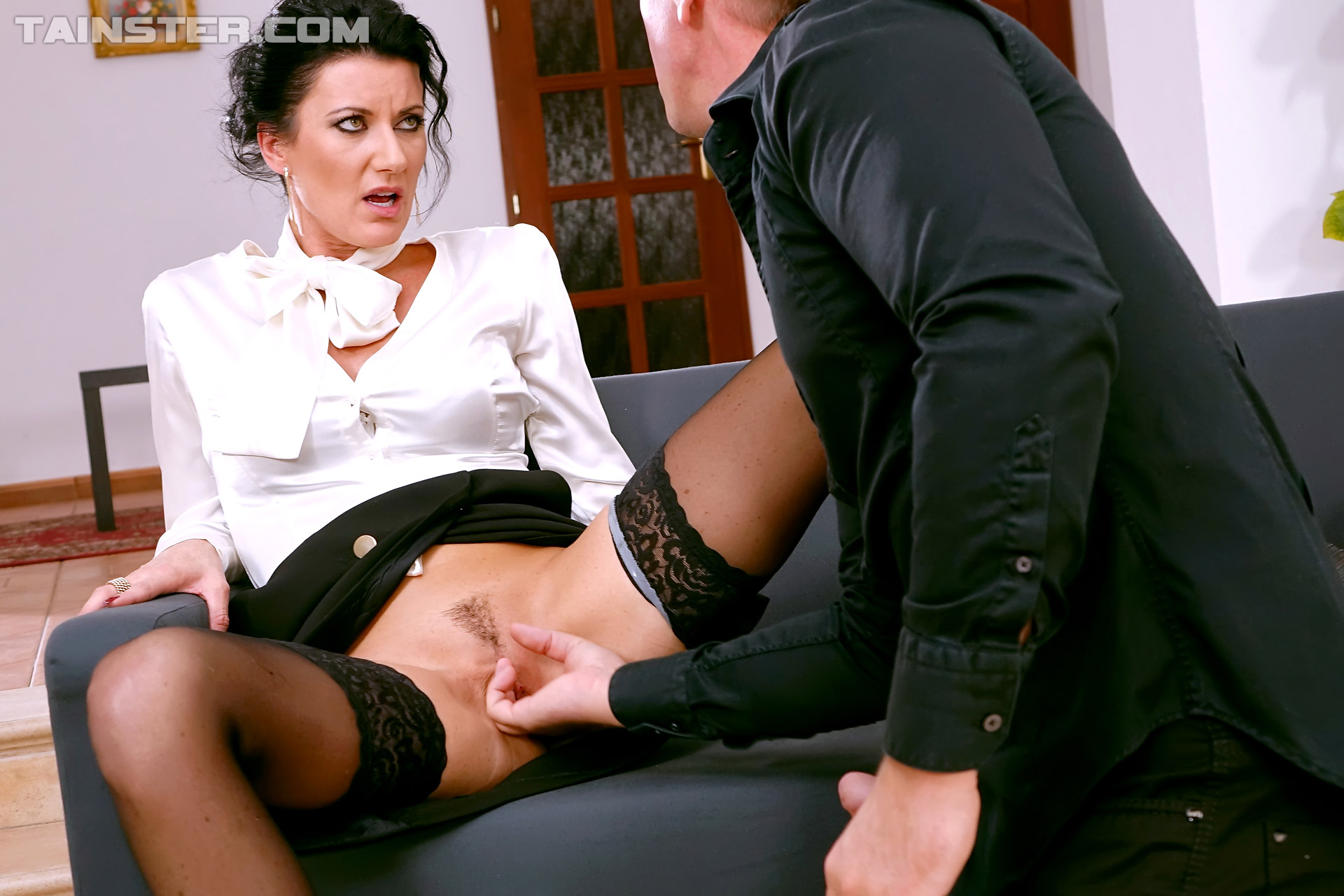 elegant brunette opens stockinged legs for her man as they launch