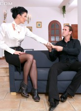 Elegant brunette opens stockinged legs for her man as they launch into fully-clothed sex