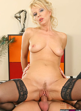 Lusty blonde milf in black holdups giving head before doggystyle