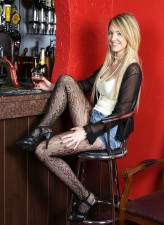 Bold blondie Katie Kay strips to her patterned pantyhose in the local pub