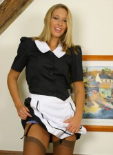 Blonde waitress strips to black garters and flashes beaver