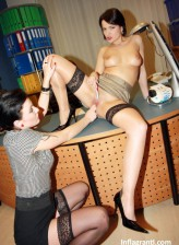 Two German lesbians Maria Mia & Fabienne spread stocking-clad legs on the table for hot pussy play