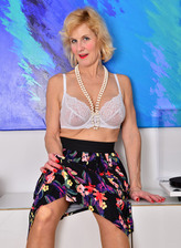Beautifully aged UK lady Molly Maracas boasts her classy lingerie with a long-line girdle and stockings