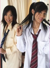 Uniformed Asian coeds go lesbo working their sweet hairy pussies