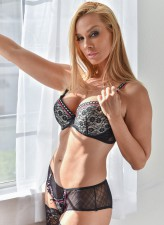 Perfectly slim blonde milf boasts her hot bod in luscious lacy lingerie and matching holdups