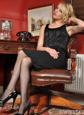 British blonde April Paisley in black lingerie and stockings