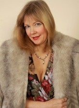 Older lady strips her fur coat and dress to pose in black nylons
