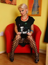 Gorgeous UK blondie Natalie pulls up her mesh tights and gets naughty