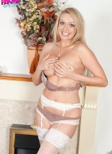 Gorgeous UK milf Amber Amber Jayne strips off to her panties, suspender belt and stockings