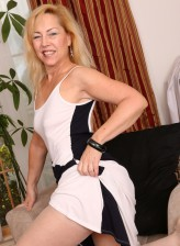 Round-assed mature Badd Gramma aka Goddess Justine boasts her pantyhosed buns