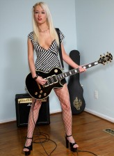 Blonde rock babe clad in white fishnet pantyhose riding a sybian