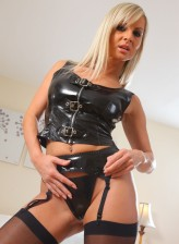Hot British dominatrix Vendula wants to be worshipped in her black nylons with a PVC garter