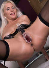Gorgeous blonde milf Kathy Anderson in black lingerie and stockings inserts a speculum