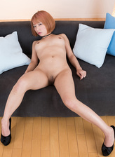 Oriental redhead Chie Kobayashi gives a stiffy with her black platform pumps and thigh high boots