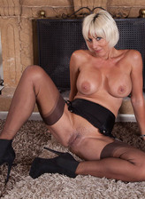 Blonde upskirt milf flashes her classy girdle attached to a pair of black stockings