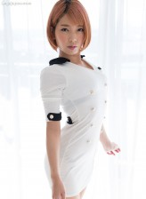 Uniformed ginger-haired Japanese Chie Kobayashi parts sexy legs in her smashing high heels