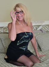 Spectacled Canadian mature Bianca peels off her strapless gown to get naughty in stockings and heels