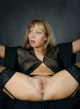 Amanda boasts amazing flexibility bending her legs in black garters and nylons