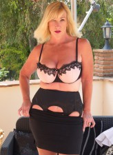 Stacked British mom Melody Charm strips classy lingerie and stockings in the sun